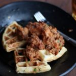 bite-sized pieces of crispy fried chicken on top of fluffy waffles