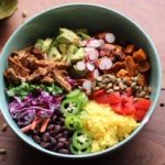 Rainbow Burrito Bowl colorfully arranged in a bowl.