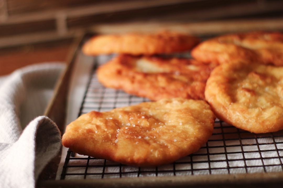 disks of fry bread on a cooling rack