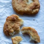pieces of fry bread on parchment paper