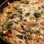 kale, butternut squash, and pancetta frittata in a skillet