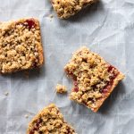 healty peanut butter and jelly bars on parchment paper