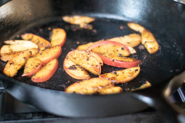 sliced apples, charred in a cast iron skillet