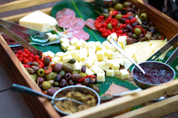 charcuterie board with dried meats, cheeses, olives, and spreads