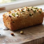 a loaf of Jalapeno Feta Beer bread on a cutting board