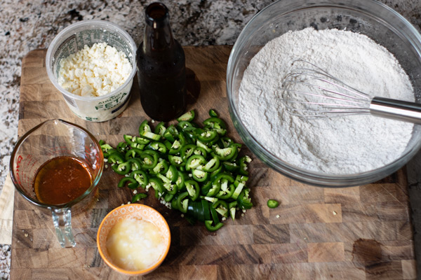 Ingredients for Jalapeno Feta Beer Bread: feta, beer, flour, salt, baking powder, jalapenos, melted butter, and honey.