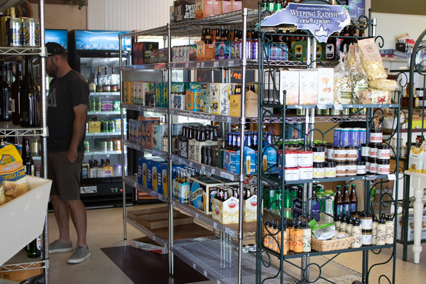 the retail area with racks and shelves of beer for sale
