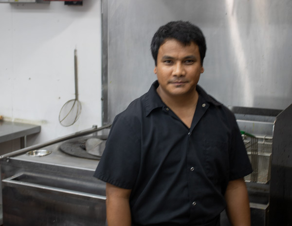 chef Sunij Rajthala in the kitchen at Masala Bay Grill