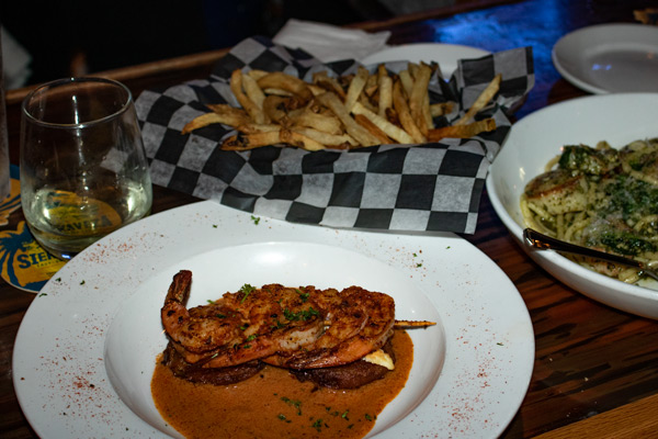 The Fried Green Tomato Napoleon at Blue Moon Beach Grill and a basket of perfectly crispy fries.