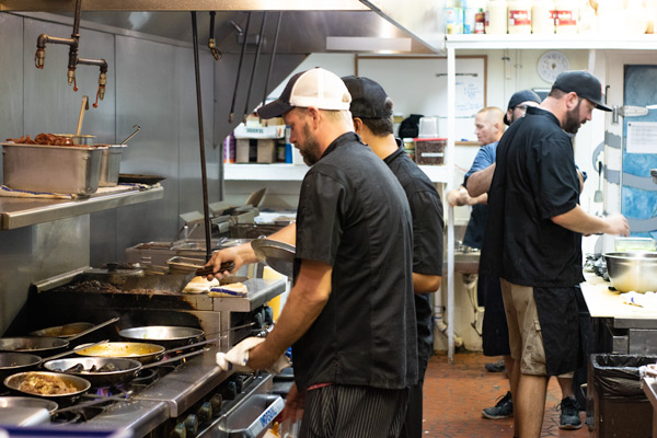 chefs in the kitchen at Blue Moon Beach Grill