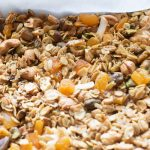 chaat masala granola on a sheet pan with parchment paper