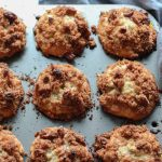 banana pecan muffins with streusel topping in a muffin pan