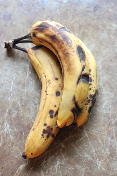 three overripe bananas in their peels