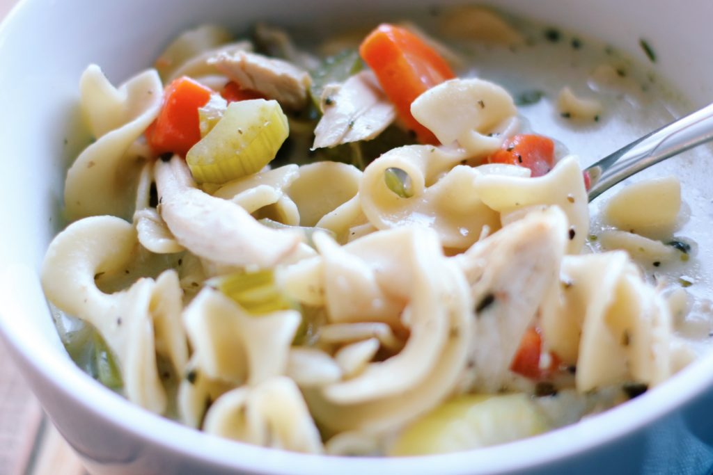 Chicken Noodle Soup with Sherry and Cream in a white bowl