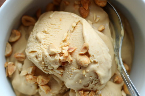 Scoops of Peanut Butter Miso Ice Cream in a white bowl with a spoon