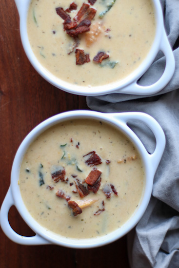 Two bowls of Sweet Potato Corn Chowder on a wooden table