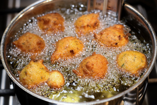 Dill hushpuppies frying in oil