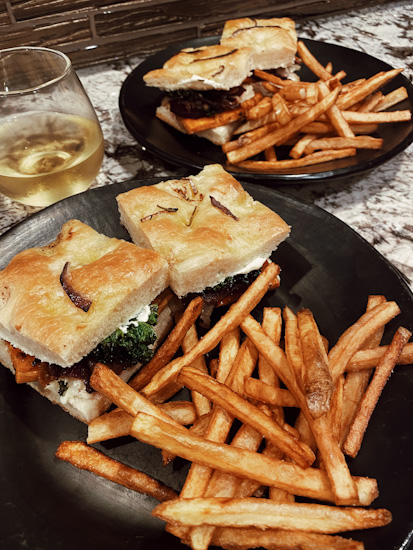 2 plates with Roasted Veggie Sandwich and Fries
