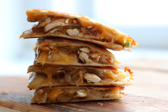 Blackened Chicken Quesadillas Stacked on a cutting board
