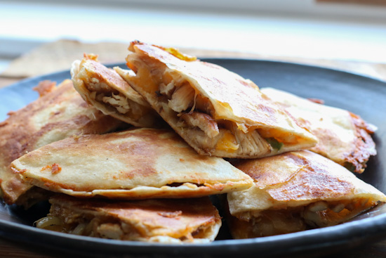 Blackened Chicken Quesadillas stacked on a plate