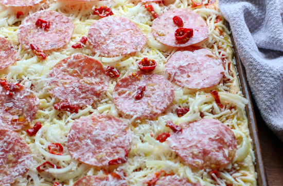 Salami and Hot Pepper Sicilian Pizza with toppings, before cooking