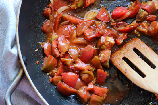 chopped tomatoes cooking in a saute pan